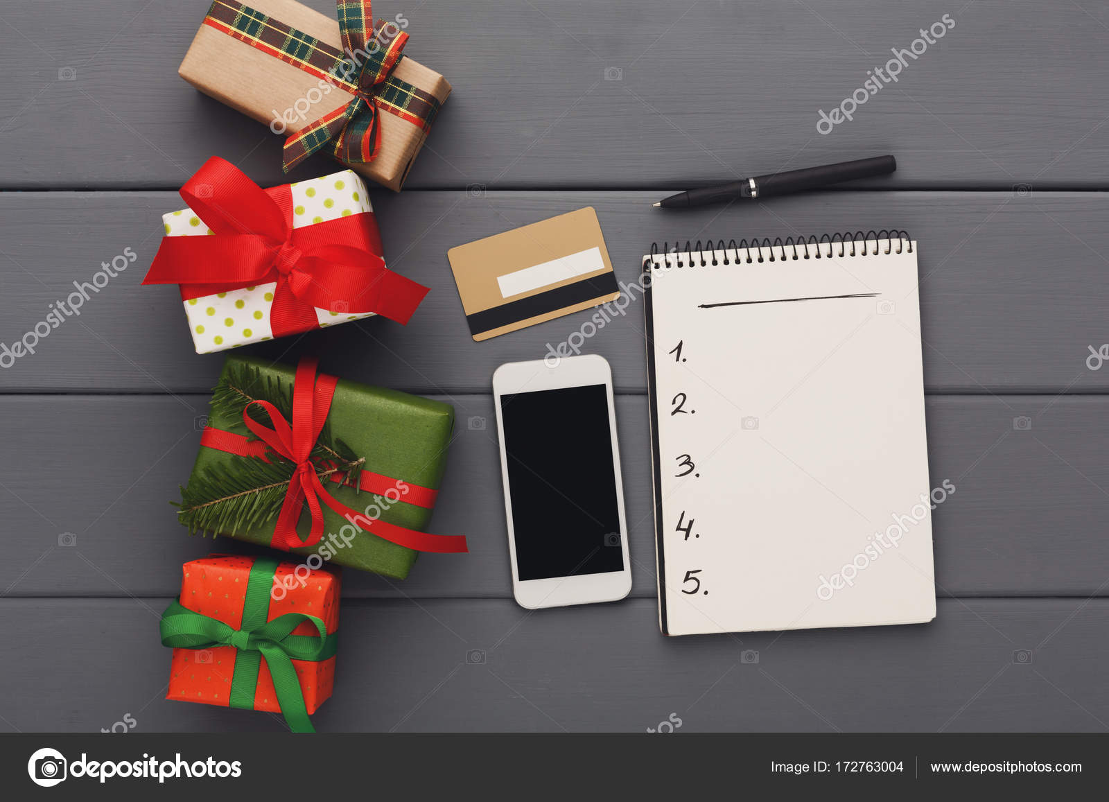 preparing gifts for christmas shopping online wood background top