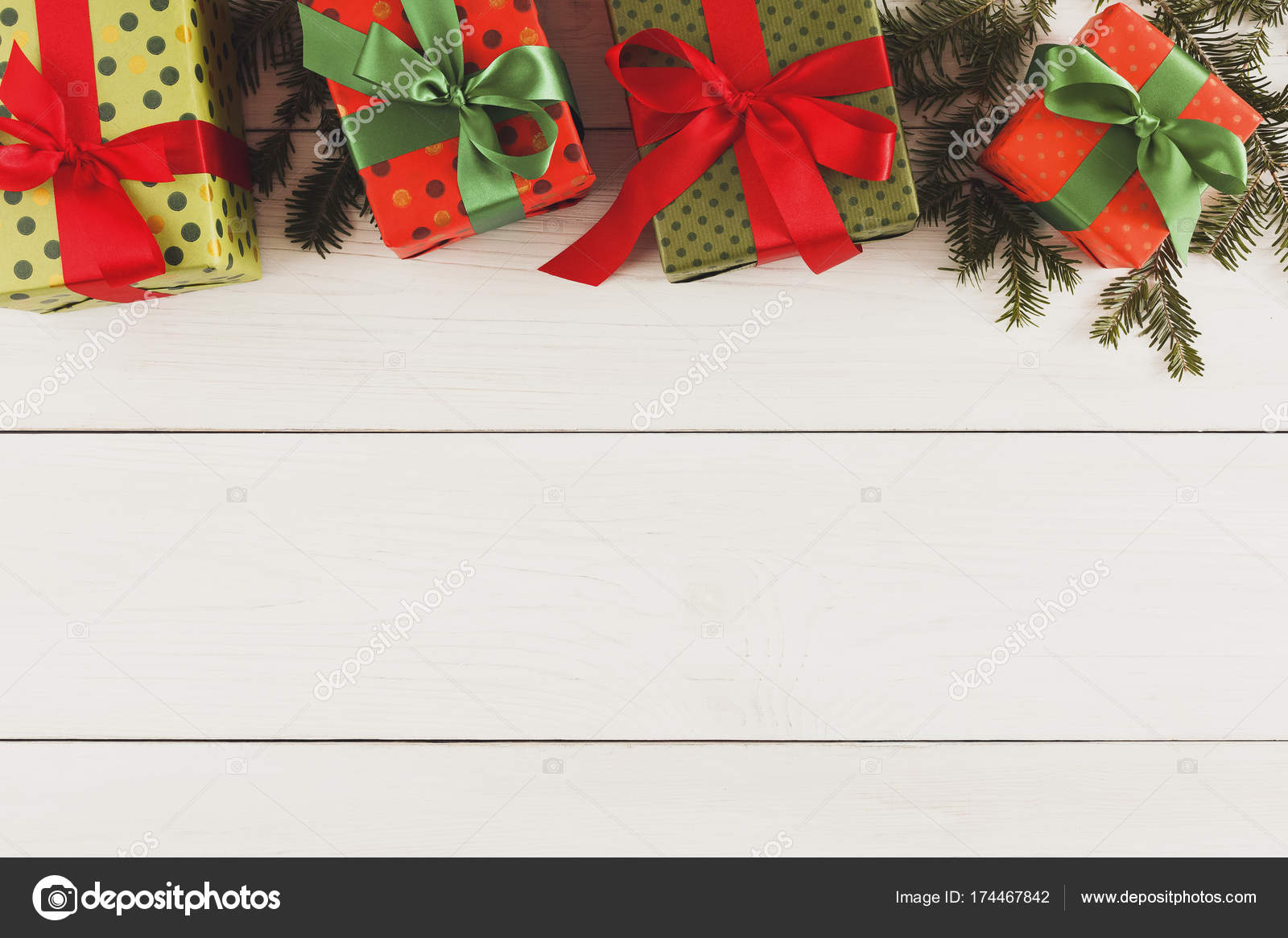 Colorful Christmas present boxes for on white wooden background ...