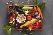 Fotografie Fresh vegetables on wooden tray with copy space