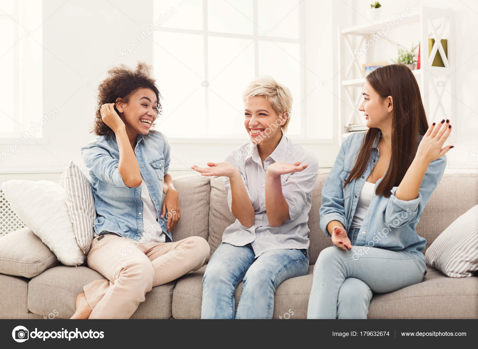 Female friends chatting at home — Stock Photo © Milkos #179632674