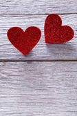 Valentine day background, handmade hearts on wood, copy space