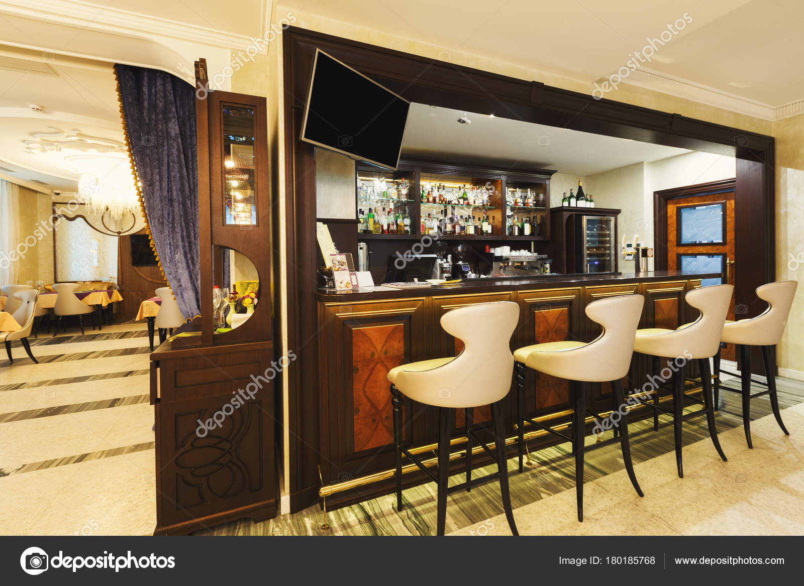 Hotel Lounge Bar With Bottle Shelfs And Seats Stock Photo