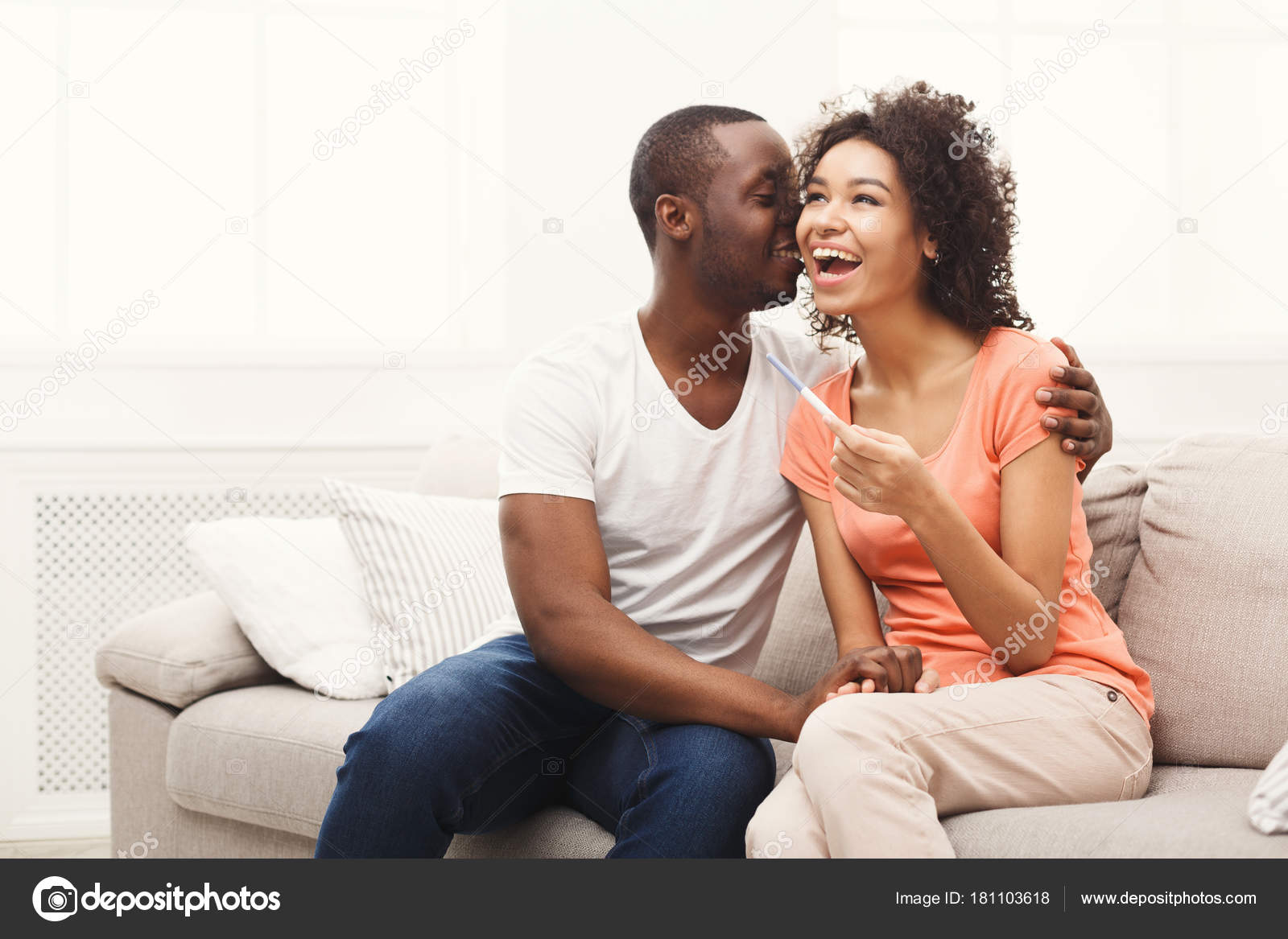 Young African American Couple Happy About Results Of Pregnancy Test Stock Photo