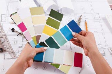 Interior designer working with palette closeup