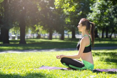 Young woman outdoors, relax meditation pose