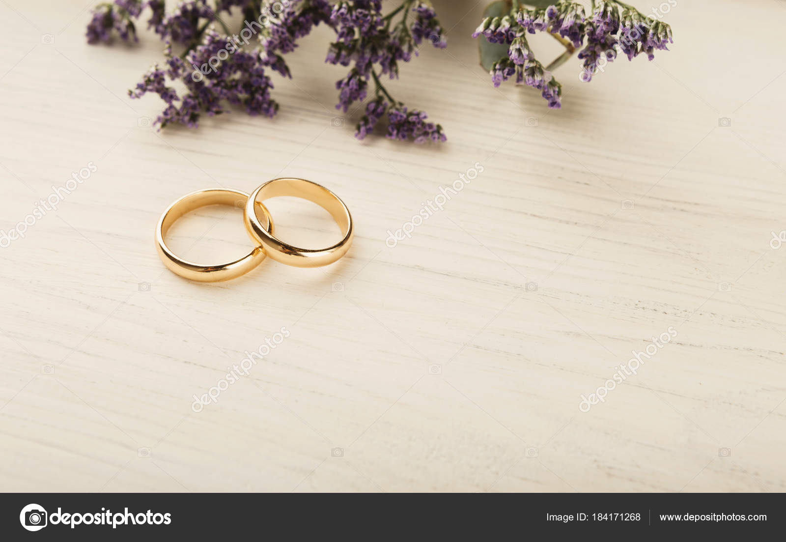 Two Golden Wedding Rings With Flower Decorations Stock