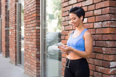 Woman choose music to listen during jogging