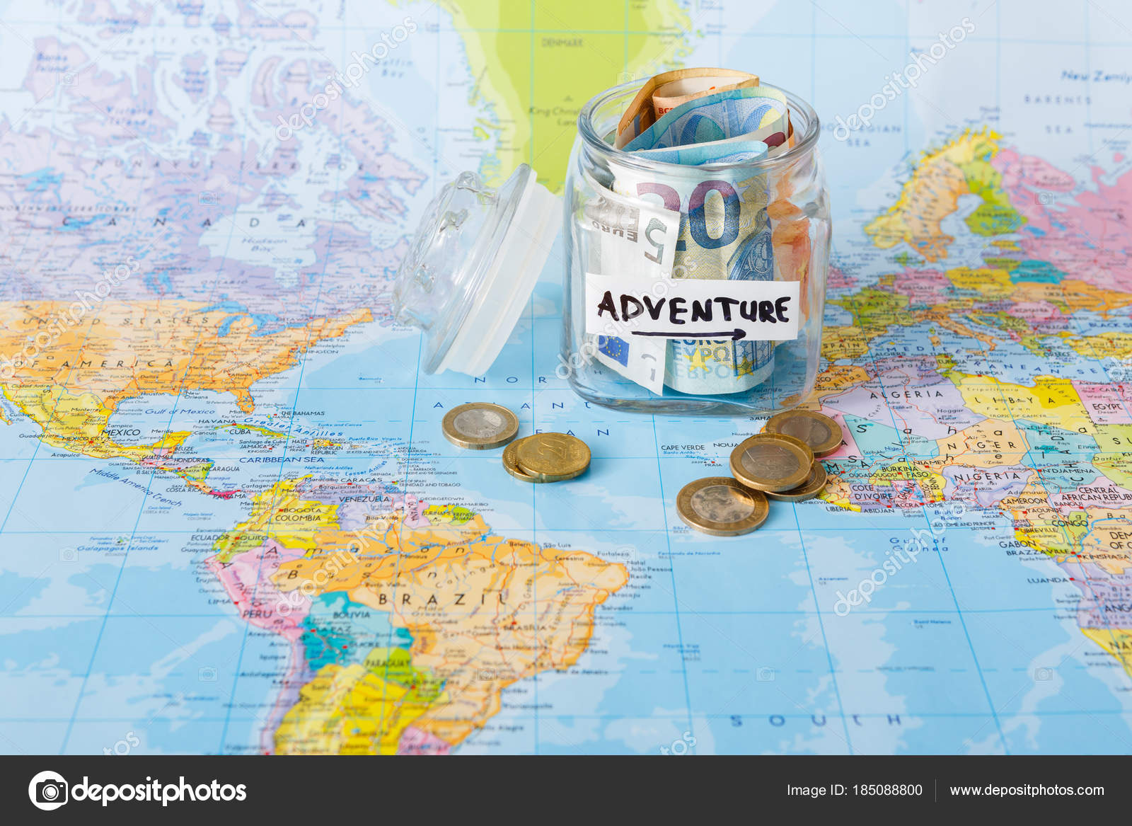 Travel budget concept money saved for vacation in glass jar on map money saved for vacation in glass jar on world map background copy space banknotes and coins for big adventure photo by milkos gumiabroncs Choice Image