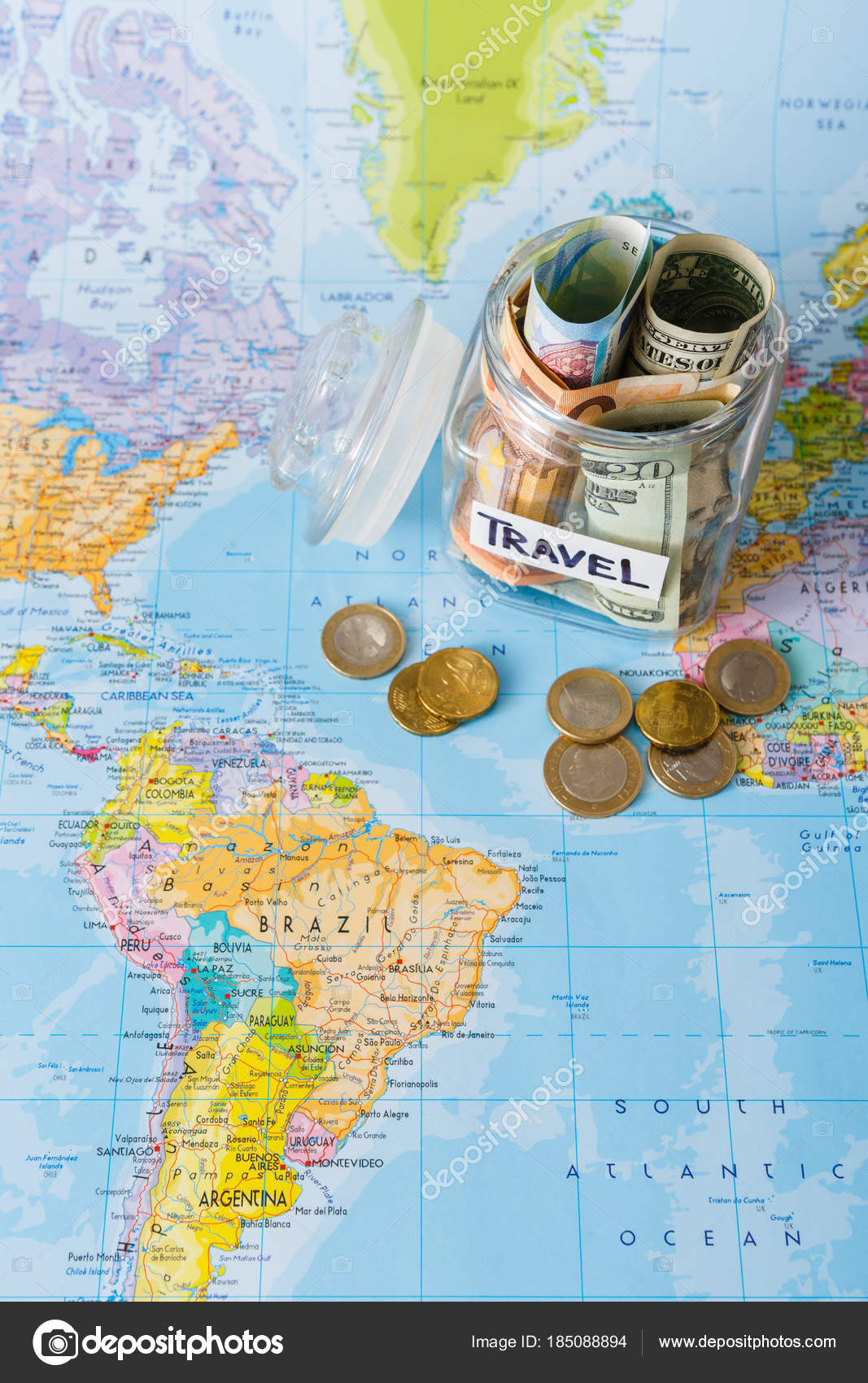 Travel budget concept money saved for vacation in glass jar on map money saved for vacation in glass jar on world map background top view banknotes and coins for big adventure photo by milkos gumiabroncs Choice Image