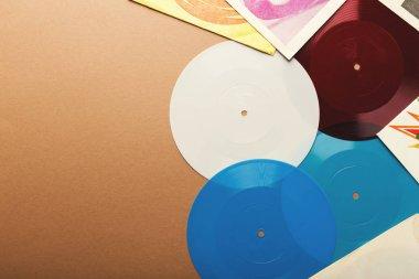 Old retro vinyl records on beige background, top view