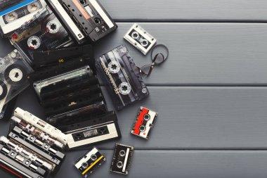 Vintage audio cassettes border on gray planks background
