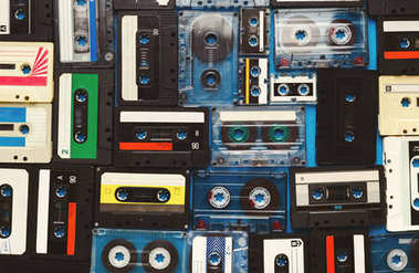 Vintage audio cassettes blue background