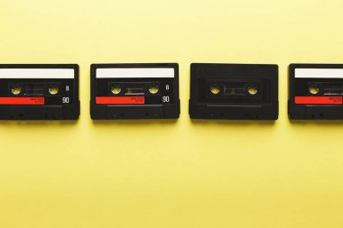 Creative background with audio cassettes of different colors