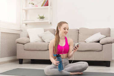 Happy fitness woman having rest in gym