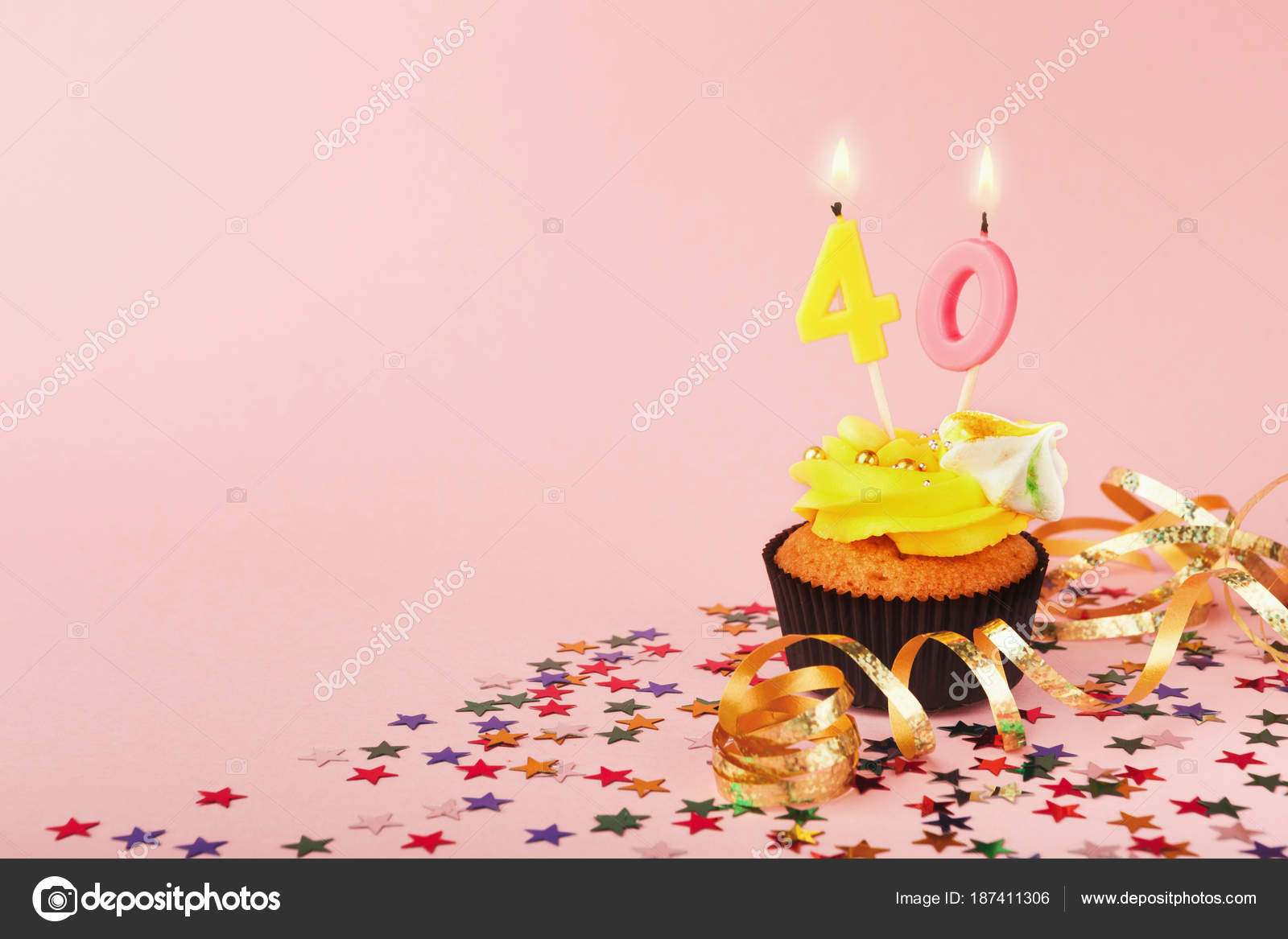 40th Birthday Cupcake With Candles Sprinkles And Ribbon On Pink Background Card Mockup Copy Space Party Holiday Concept Photo By
