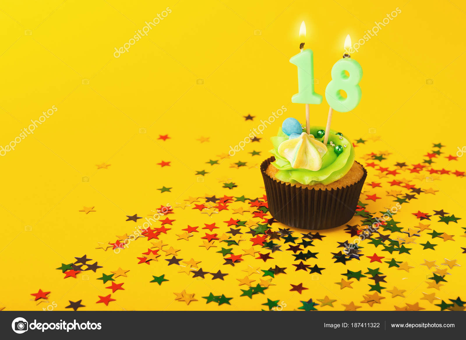 18th Birthday Cupcake With Candle And Sprinkles On Yellow Background Card Mockup Copy Space Party Holiday Concept Photo By