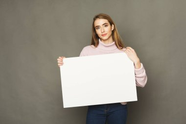 Young smiling woman with blank white paper