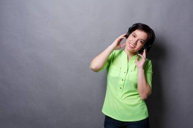 Woman with enjoying music in earphones