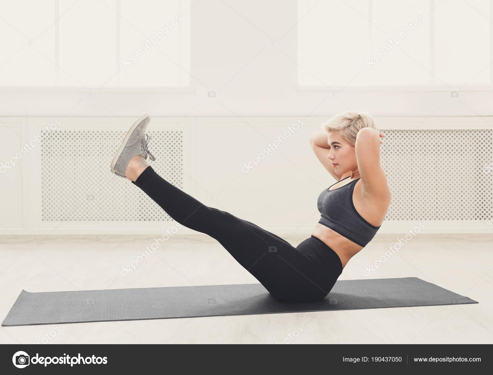 Woman Training Yoga In Boat Pose Stock Photo C Milkos 190437050