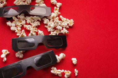 Movie background. Popcorn and 3D glasses on red backdrop, copy space, entertainment concept stock vector