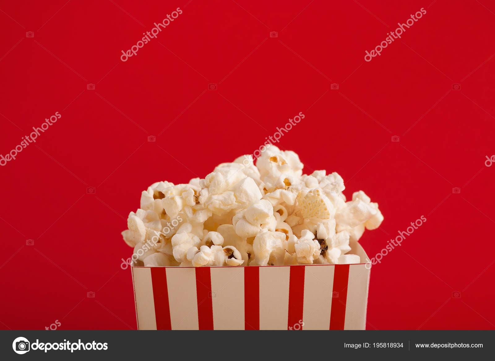Bucket Of Popcorn On Red Background Stock Photo Image By C Milkos 195818934