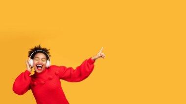 Portrait of excited black girl enjoying music