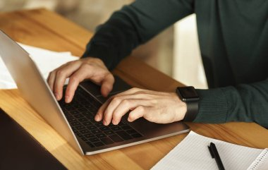 Unrecognizable Guy Using Laptop Typing Working In Modern Office, Cropped