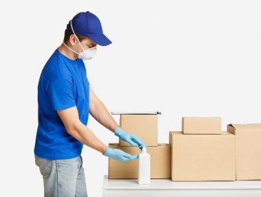 Courier disinfects hands with antiseptic before delivering parcel