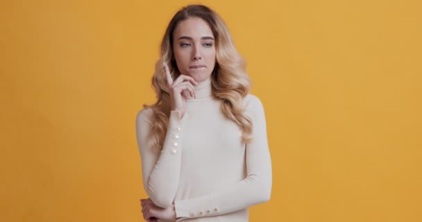 Blonde girl thinking about problem solution and has great idea