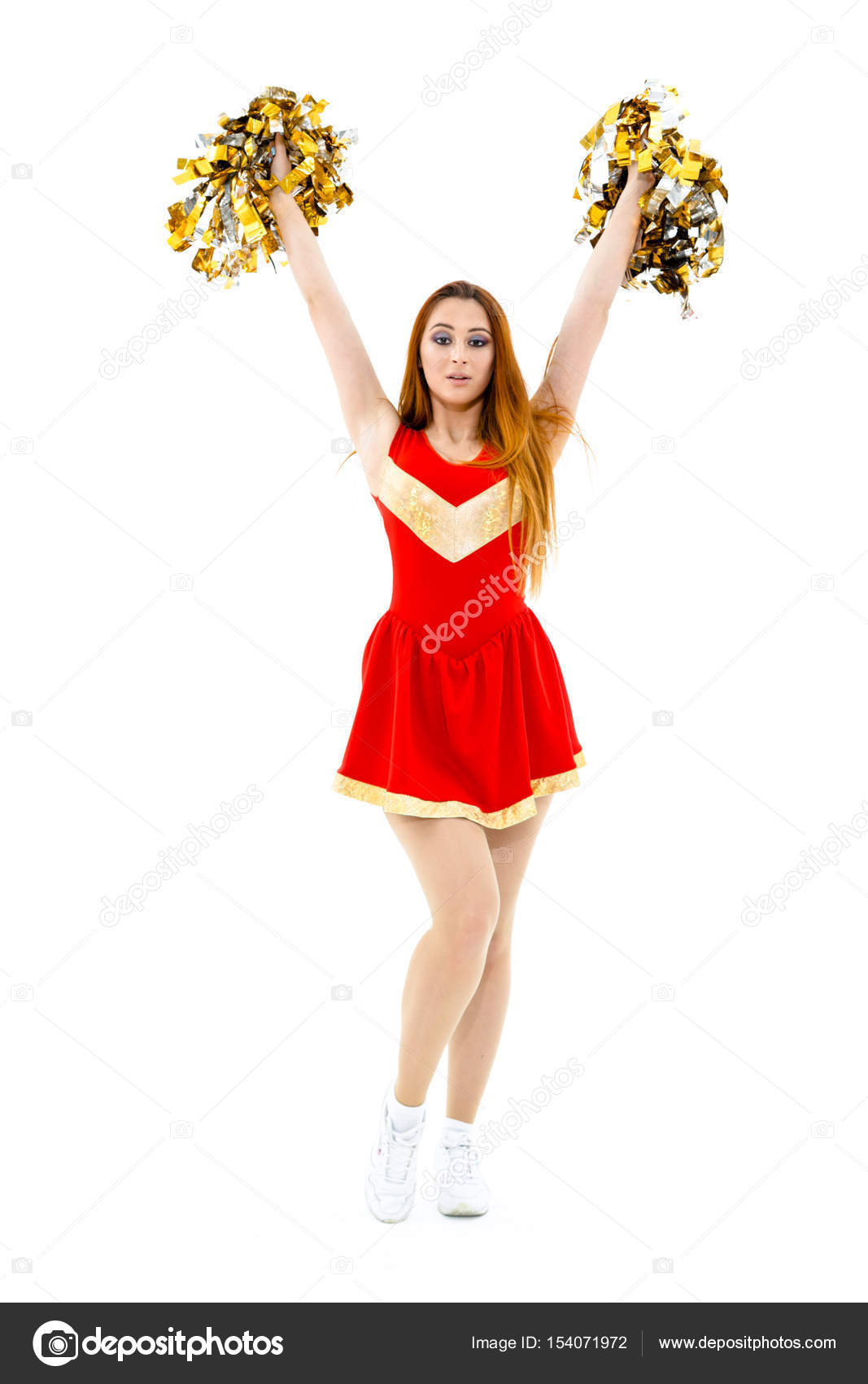 Beautiful Cheerleader In Red Costume Posing With Pom Poms Photo By