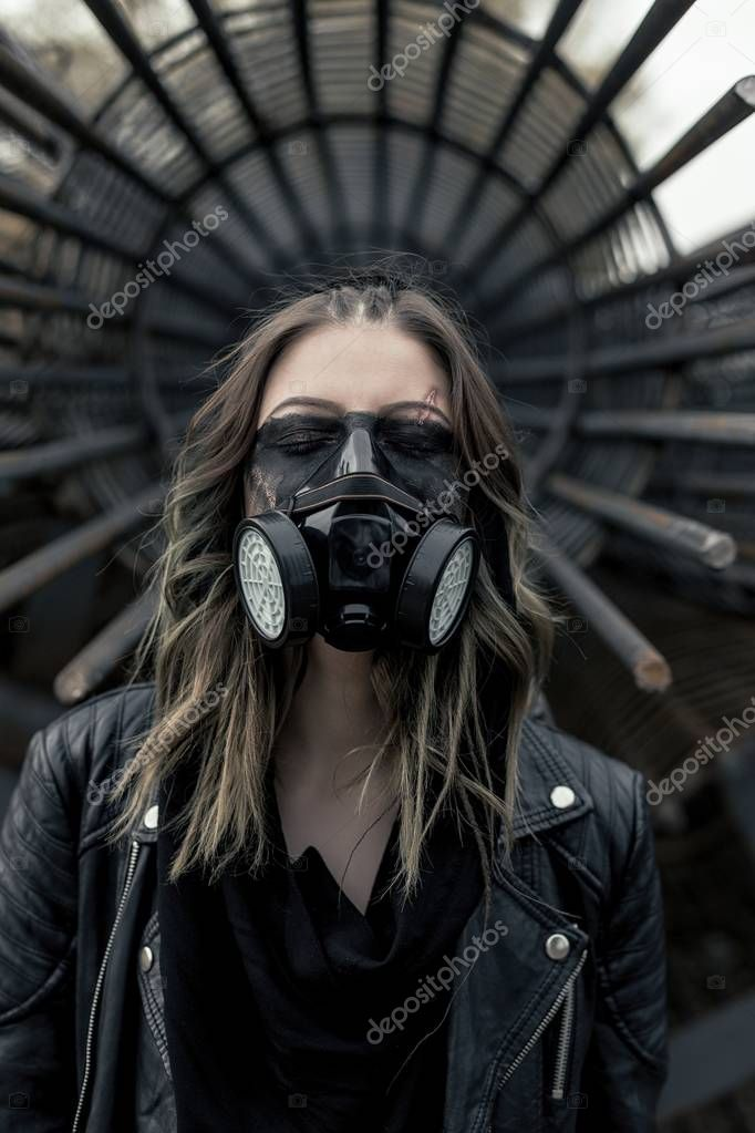 Young woman wearing respirator