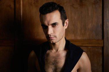Portrait of handsome young brunette man in the studio stock vector