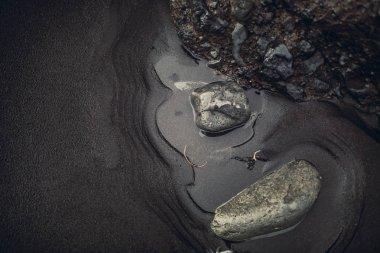 Black lava with stones