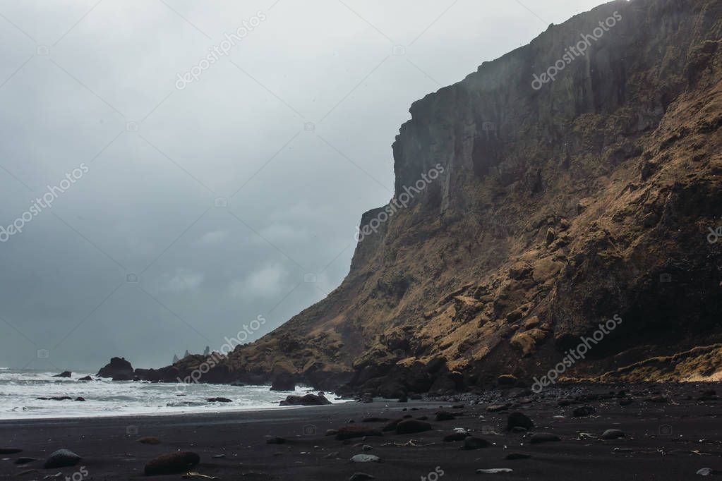 Seashore with black sand and stones