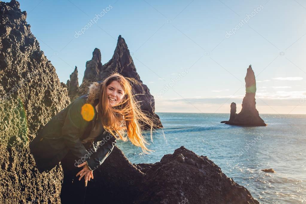 Girl standing on seashore stone