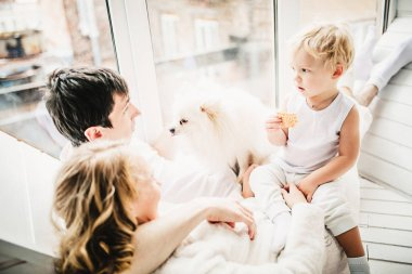 Family having homely home with doggie