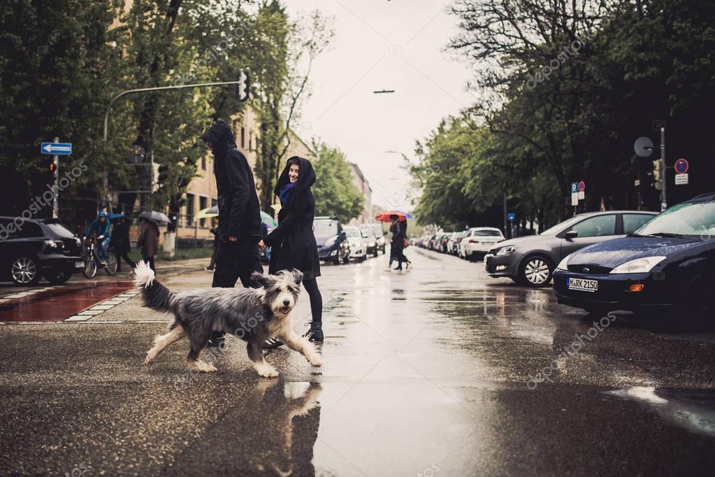 Couple strolling across road on street