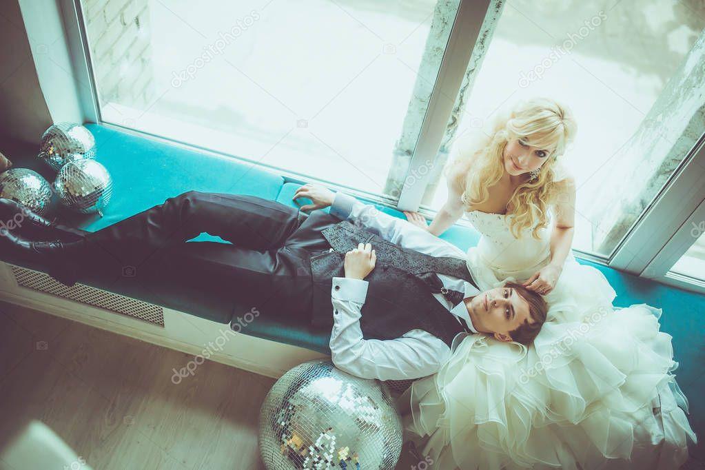 Groom laying on bride knees