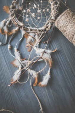 dream catcher with branches and feathers