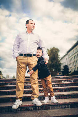 father and son on city stairs