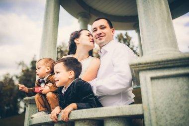 lovely family on stone balcony