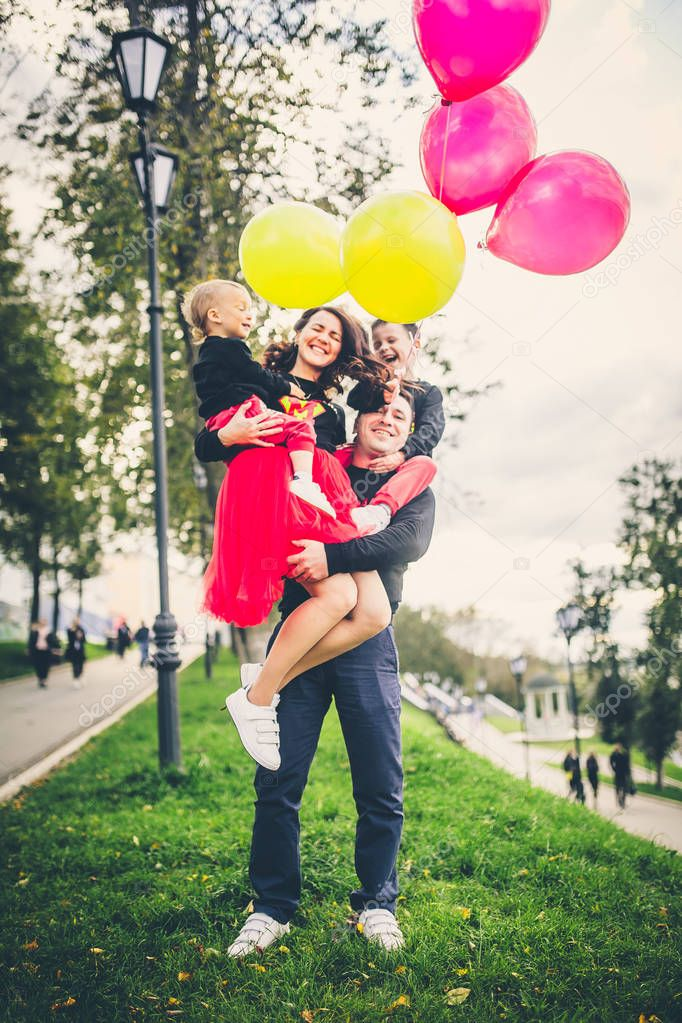 family in park with balloons