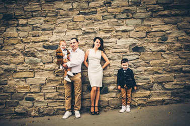 lovely family near brick wall