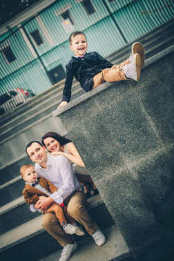 lovely family on city stairs
