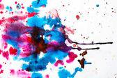 Fotografie Nahaufnahme von farbigen Aquarell Flecken auf weißem Papierhintergrund