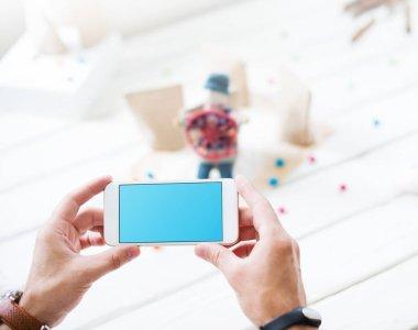 Man taking a photo using smartphone