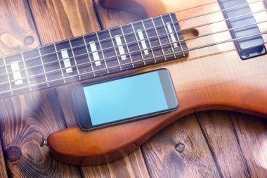 Black smartphone mockup with guitar