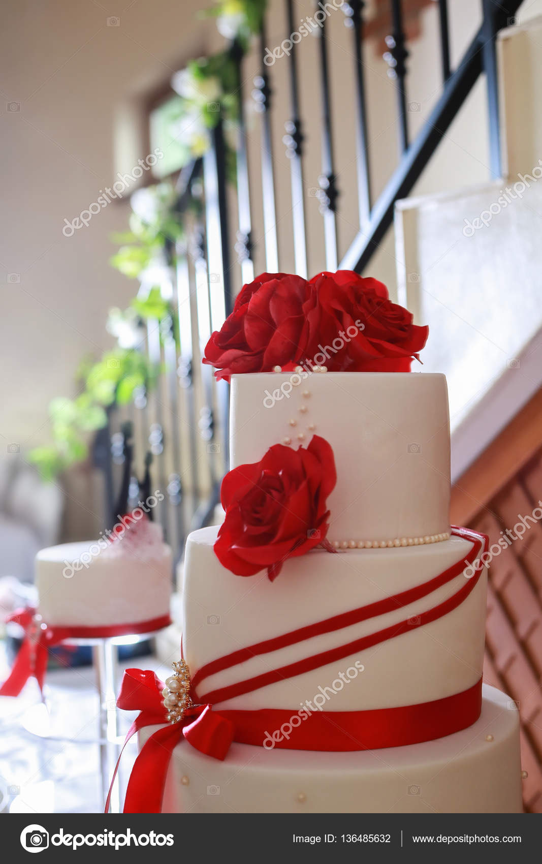 White 4 Tier Wedding Cake Detail With Red Edible Marzipan Flower