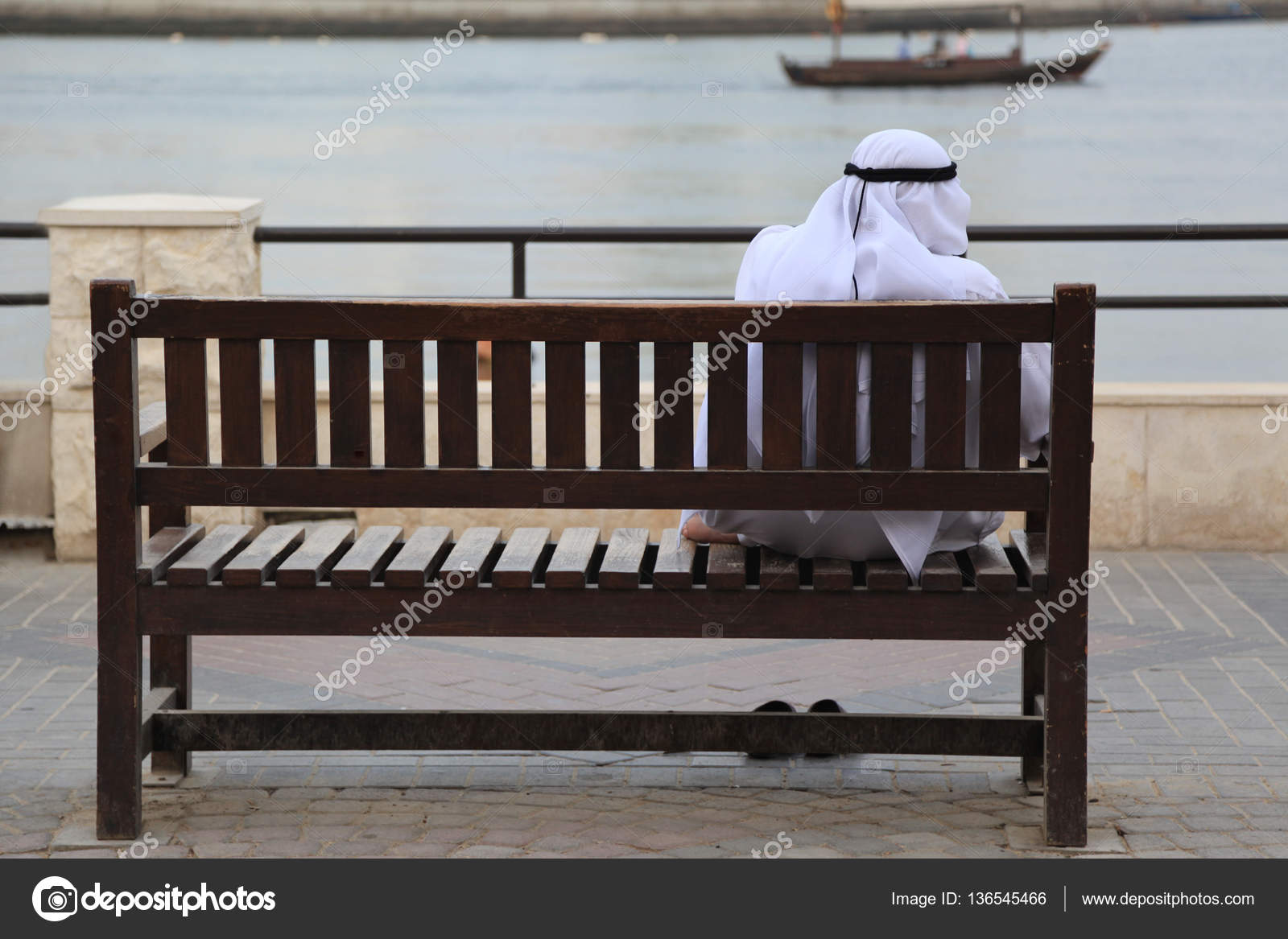 Groovy Arab Man In Dishdasha Sitting On A Wooden Bench At Creek Pdpeps Interior Chair Design Pdpepsorg