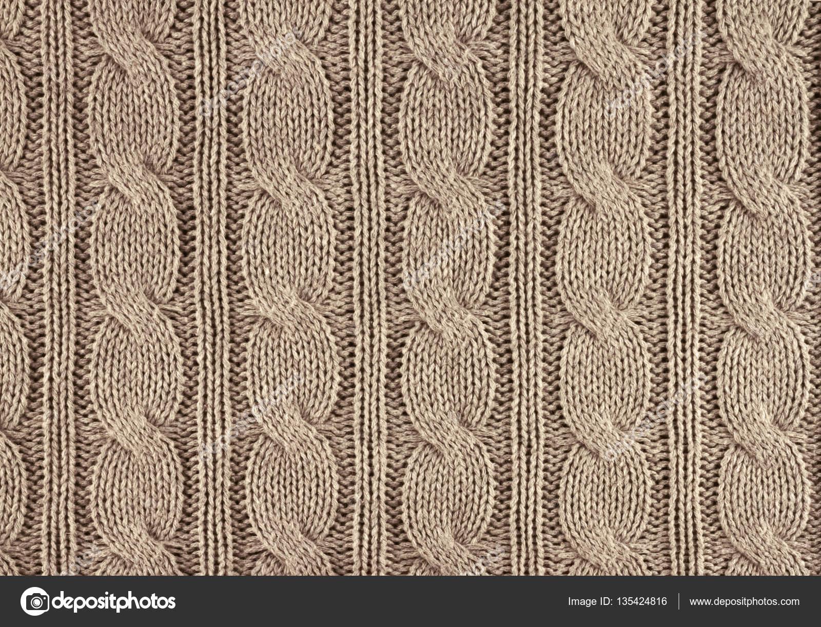 308029378d10 Μπεζ πλεκτή υφή φόντου με ένα closeup μοτίβο — Εικόνα από rustamank. Βρείτε  παρόμοιες εικόνες